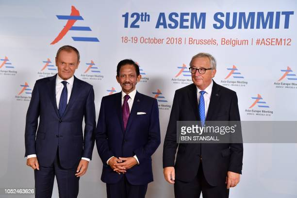 President of the European Commission JeanClaude Juncker and European Council President Donald Tusk welcome Brunei's Darussalam's Sultan Haji Hassanal...