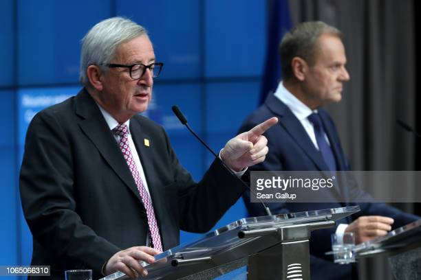 President of the European Commission JeanClaude Juncker and European Council President Donald Tusk speak during a press conference after attending a...