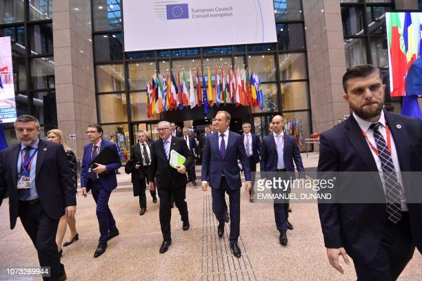 President of the European Commission Jean-Claude Juncker and European Council President Donald Tusk leave after after the European Council on...
