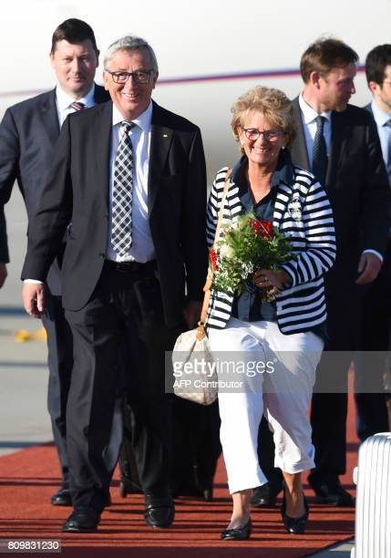President of the European Commission JeanClaude Juncker and his wife Christiane Frising arrival at the airport in Hamburg northern Germany on July 6...