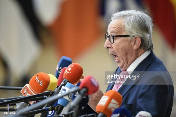 TOPSHOT President of the European Commission JeanClaude Juncker reacts as he speaks to journalists during an European Union leaders' summit focused...