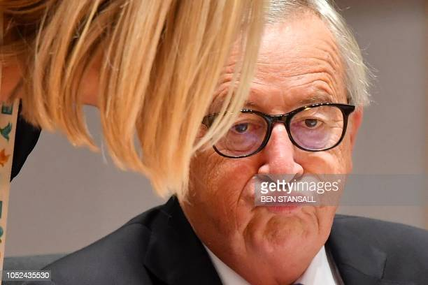 TOPSHOT President of the European Commission JeanClaude Juncker reacts during the second day of a European Union leaders summit at the European...