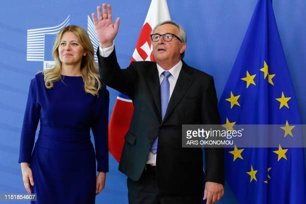 President of the European Commission JeanClaude Juncker waves as he welcomes Slovakia's President Zuzana Caputova at the European Commision...