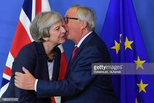President of the European Commission JeanClaude Juncker welcomes Britain's Prime Minister Theresa May upon her arrival at the European Commission in...