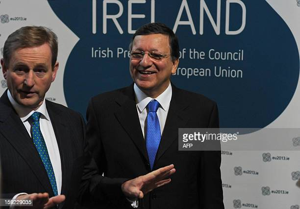 President of the European Commission Jose Manuel Barroso and Irish Prime Minister Enda Kenny talk as they arrive for a meeting between the Irish...