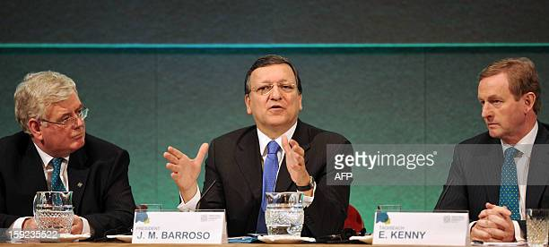 President of the European Commission Jose Manuel Barroso sits flanked by Irish Prime Minister Enda Kenny and Deputy Prime Minister Eamon Gilmore...