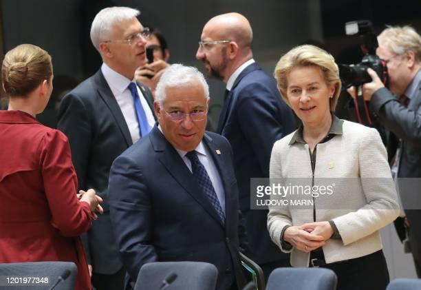 President of the European Commission Ursula von der Leyen and Portugal's Prime Minister Antonio Costa look on, next to President of the European...
