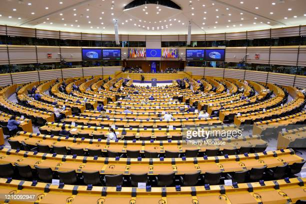 President of the European Commission Ursula von der Leyen delivers a speech in the European Parliament on April 16 in Brussels, Belgium. Due to the...