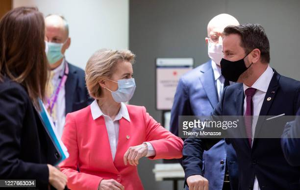 President of the European Commission Ursula von der Leyen elbow bumps Luxembourg Prime Minister Xavier Bettel during an EU summit on July 17, 2020 in...