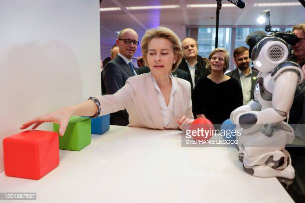 """President of the European Commission Ursula von der Leyen looks at the invention """"Do you Speak Robot?"""" past """"NAO"""" , a programmable humanoid robot..."""