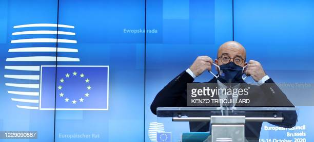 President of the European Council Charles Michel adjusts his face mask during a press conference on the first day of the face-to-face European Union...