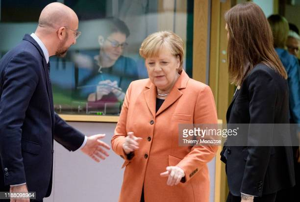 President of the European Council Charles Michel is talking with the German Chancellor Angela Merkel under the regards of the Belgium Prime Minister...
