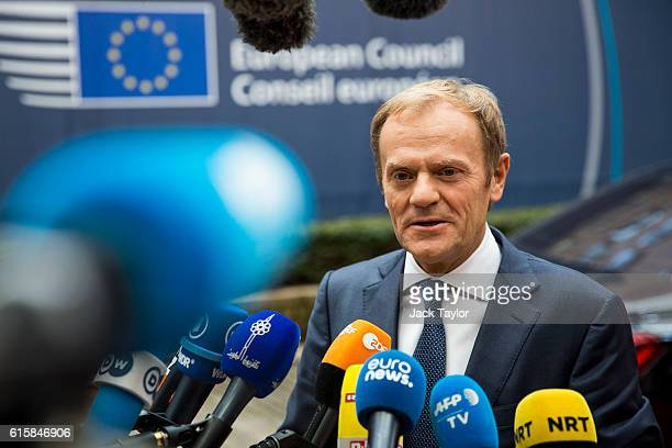 President of the European Council Donald Tusk addresses assembled media as he arrives at the Council of the European Union on the first day of a two...