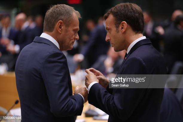 President of the European Council Donald Tusk and French President Emmanuel Macron chat prior to a meeting of EU leaders to discuss Brexit at the...