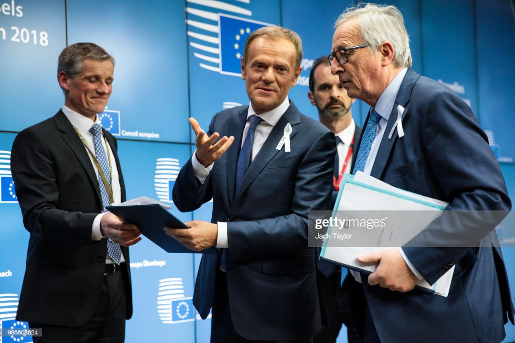 President of the European Council Donald Tusk (C) and President of the European Commission Jean-Claude Juncker (R) leave following a press conference after a European Council Meeting at the Council of the European Union on March 22, 2018 in Brussels, Belgium. European Union leaders meet today for the two-day European Council. The agenda will include discussion on the recent nerve agent attack in Salisbury, which the UK holds the Russian state responsible, and US President Donald Trump's announcement on tariffs for steel and aluminium imports. The proposed Brexit transition deal between the European Union and the United Kingdom is also expected to be approved.
