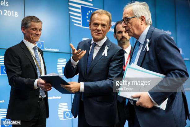 President of the European Council Donald Tusk and President of the European Commission JeanClaude Juncker leave following a press conference after a...