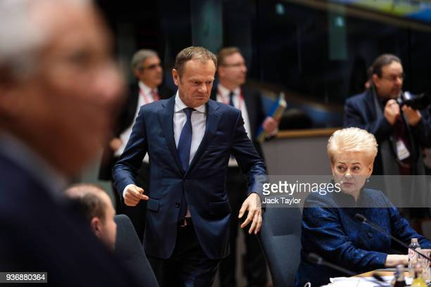 President of the European Council Donald Tusk arrives as President of Lithuania Dalia Grybauskaite looks on ahead of roundtable discussions in the...