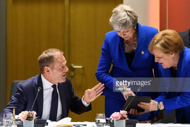 President of the European Council Donald Tusk, British Prime Minister Theresa May and German Chancellor Angela Merkel talk at a round table meeting...