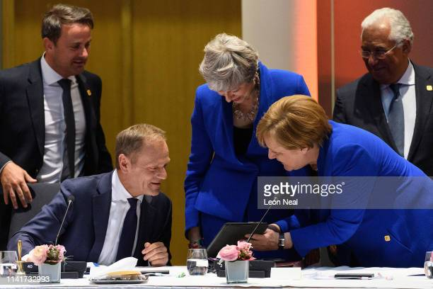 President of the European Council Donald Tusk British Prime Minister Theresa May and German Chancellor Angela Merkel talk at a round table meeting on...