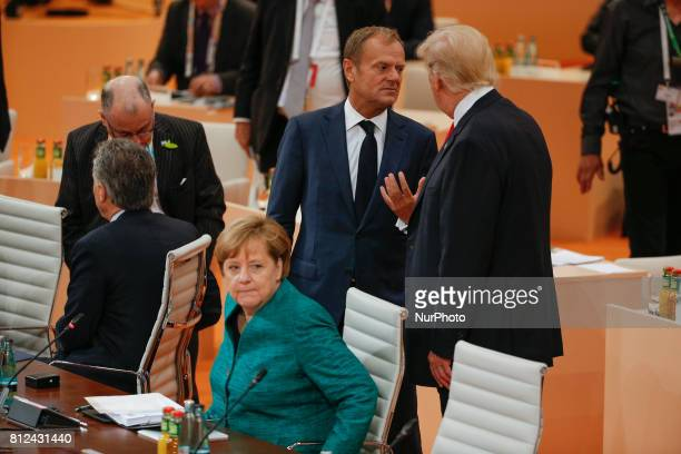 President of the European Council Donald Tusk is seen speaking to US president Donald Trump ahead of the thrid plenary session of the G20 summit on 8...