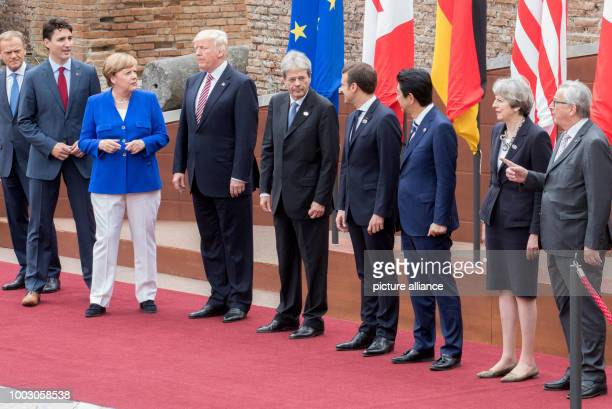 President of the European Council Donald Tusk poses next to Canada's Prime Minister Justin Trudeau Germany's Chancellor Angela Merken US President...
