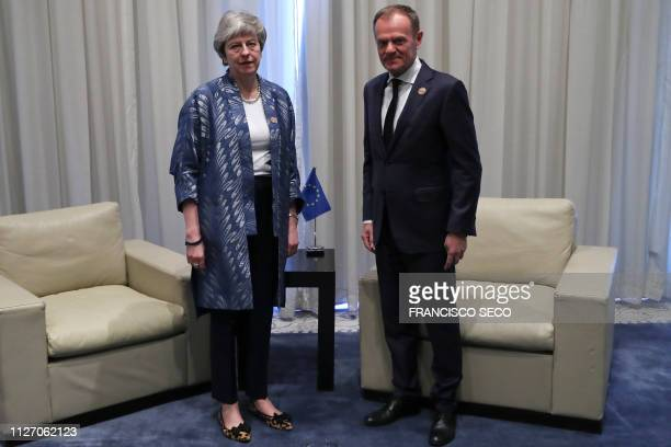 President of the European Council Donald Tusk poses with British Prime Minister Theresa May during a bilateral meeting on February 24 on the...