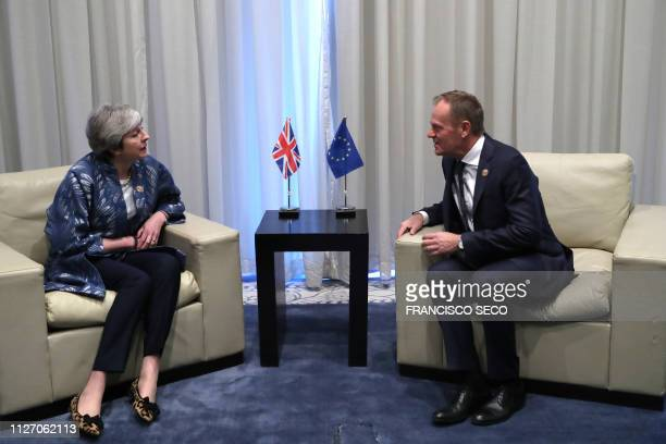 President of the European Council Donald Tusk speaks with British Prime Minister Theresa May during a bilateral meeting on February 24 on the...
