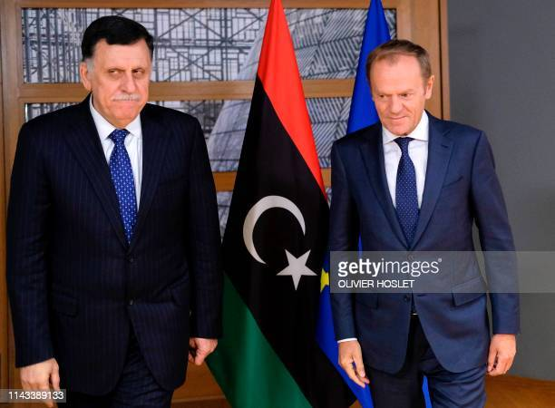 President of the European Council, Donald Tusk welcomes Libyan Prime Minister Fayez al-Sarraj prior to a meeting in Brussels on May 13, 2019.