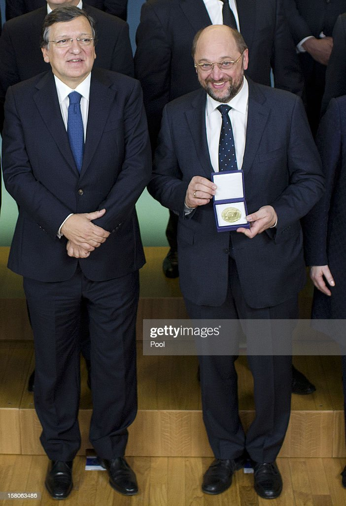 President of the European Parliament Martin Schulz (R) holds the medal of the Nobel Peace Prize as he poses with President of the European Commission Jose Manuel Barroso (L) and others EU head of states pose for a picture before a working luncheon at the Gamle Logen hosted by Norway's Prime Minister for the EU leaders while they attend the Nobel Peace Prize Award Ceremony at Oslo City Hall on December 10, 2012 in Oslo, Norway. The European Union is collecting this year's prestigious Nobel Peace Prize for uniting the continent after two World Wars especially while during economic crisis.