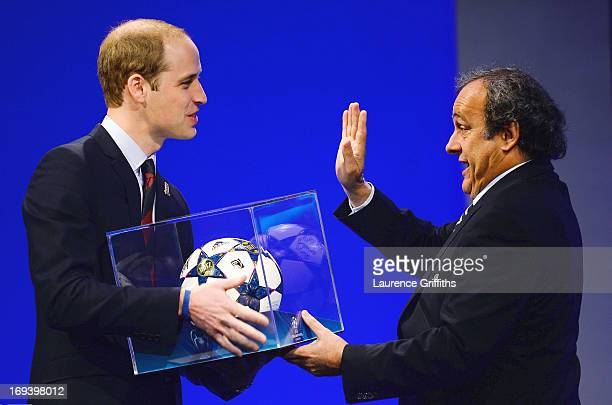 President of The FA Prince William, Duke of Cambridge is presented a match ball by UEFA President Michel Platini during the UEFA Congress at the...