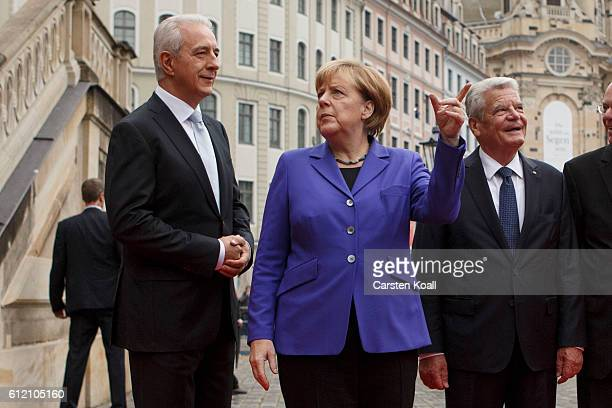 President of the Federal Council and Prime Minister of Federal Sate of Saxony Stanislaw Tillich welcomes German Chancellor Angela Merkel and German...