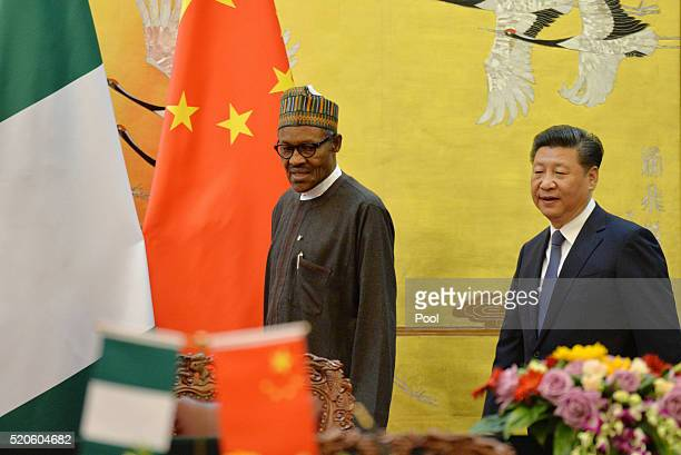 President of the Federal Republic of Nigeria Muhammadu Buhari and Chinese President Xi Jinping attend the signing ceremony at Great Hall of the...