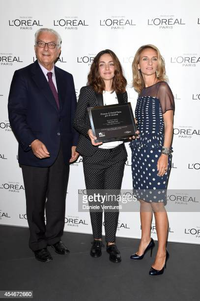 President of the Festival Paolo Baratta and brand director of L'Oreal Paris Italia Stefania Fabiano pose with winner Valentina Corti at the 'L'Oreal...