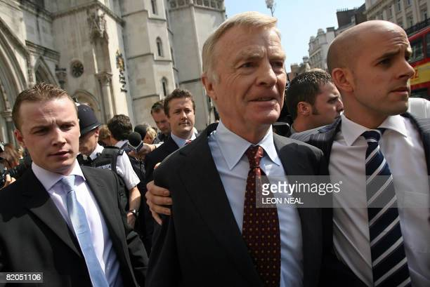President of the FIA ( Max Mosley leaves the High Court, in central London, on July 24, 2008. World motorsport chief Max Mosley won his privacy case...