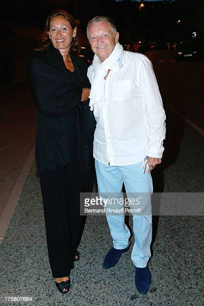President of the Football Club Olympique Lyonnais JeanMichel Aulas and his wife Nathalie attend 'La Contrebasse' play at 29th Ramatuelle Festival Day...