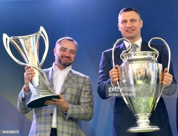 President of the Football Federation of Ukraine Andriy Pavelko and Mayor of Kiev and former boxing champion Vitali Klitschko hold men's and the...