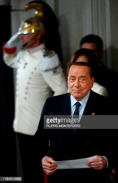 President of the Forza Italia party Silvio Berlusconi arrives to address the media following a meeting with the Italian President as part of a second...