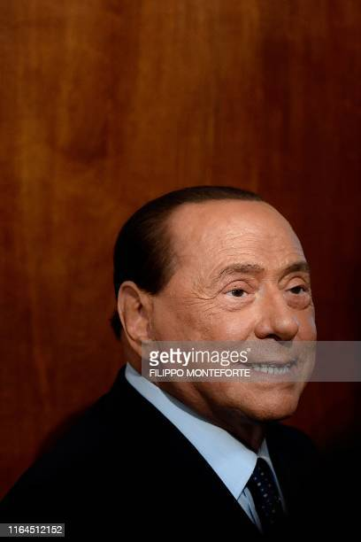 President of the Forza Italia party Silvio Berlusconi leaves following a meeting with the Italian President as part of a second round of...