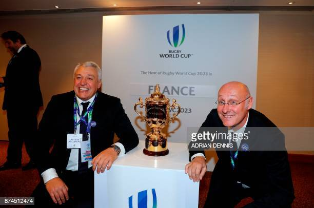 President of the French bid Claude Atcher and French rugby President Bernard Laporte pose with the trophy after France was named to host the 2023...