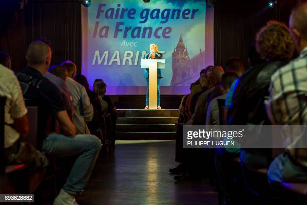 President of the French farright Front National party Marine Le Pen delivers a speech during a campaign rally on June 8 2017 in Calais in support of...