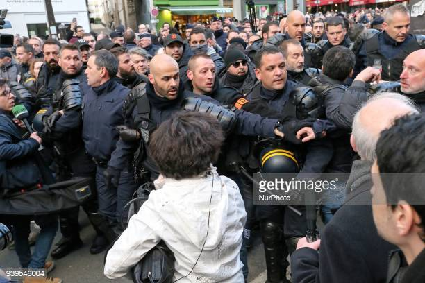 President of the French farright Front National party Marine Le Pen is prevented by other demonstrators to participate in a silent march in Paris on...