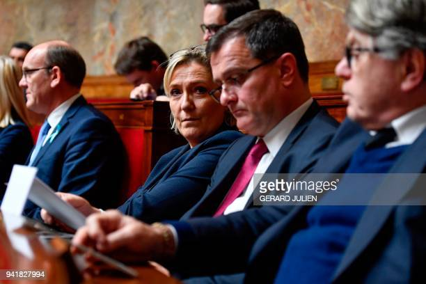 President of the French farright Front National party Marine Le Pen her companion the party's vice president Louis Aliot and party MP Gilbert Collard...