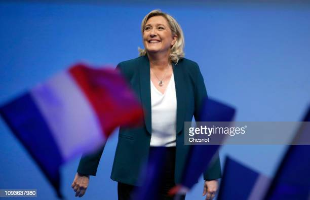 President of the French farright National Rally party Marine Le Pen smiles to the crowd during a meeting to launch the RN's campaign for the European...