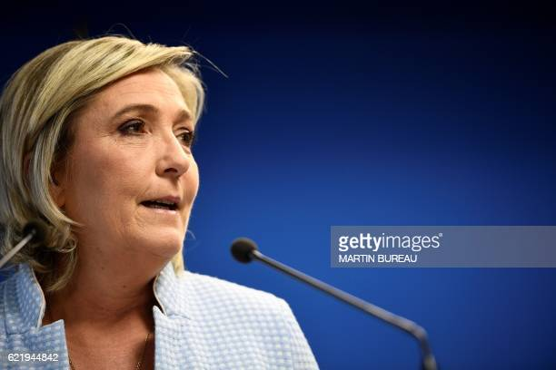 President of the French farright party and presidential candidate for the 2017 French Presidential elections Marine Le Pen delivers a speech during a...