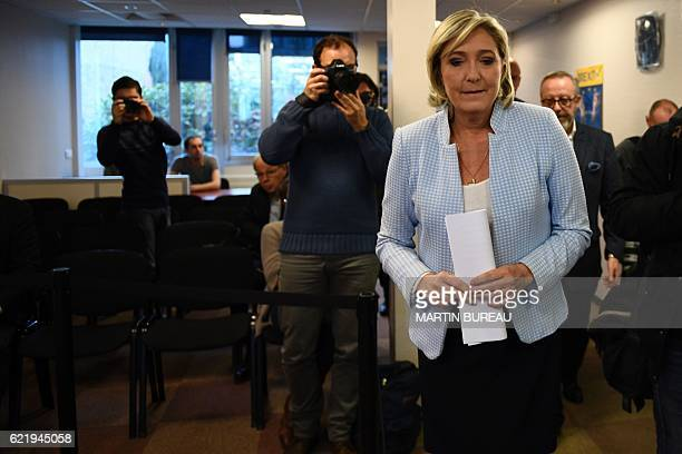 President of the French farright party and presidential candidate for the 2017 French Presidential elections Marine Le Pen leaves after delivering a...