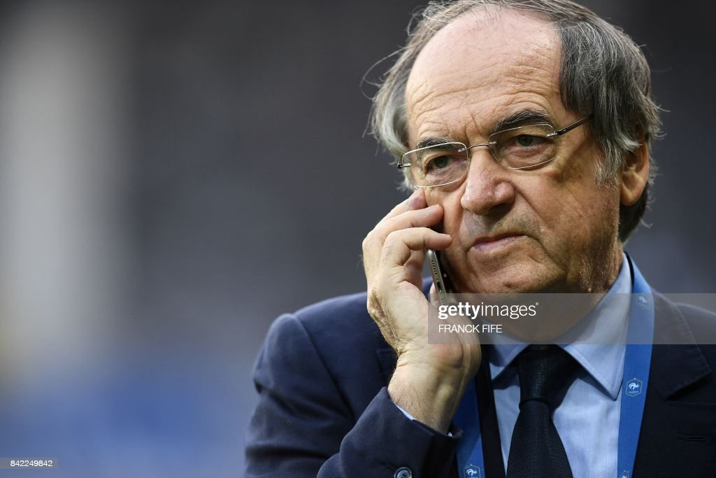 President of the French Football Federation (FFF), Noel Le Graet speaks on his mobile phone before the FIFA World Cup 2018 qualifying football match France vs Luxembourg on September 3, 2017 at the Municipal Stadium in Toulouse, southern France. /