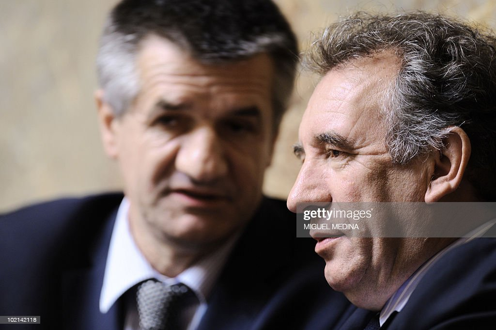 President of the French Mouvement Democrate (MoDem) party Francois Bayrou (R) speaks with French MoDem's deputy Jean Lassalle (L) during the weekly session of questions to the government on June 8, 2010 at the National Assembly in Paris.