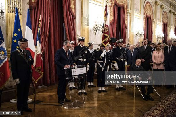 President of the French National Assembly Richard Ferrand delivers a speech as former senator and son of the late General de Gaulle Admiral Philippe...