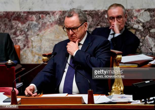 President of the French National Assembly Richard Ferrand gestures as he looks on during a session of questions to the government at the National...