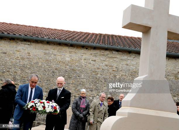 President of the French nationalist party SIEL Karim Ouchikh, and SIEL member, French writer and political activist Renaud Camus lay a wreath at the...
